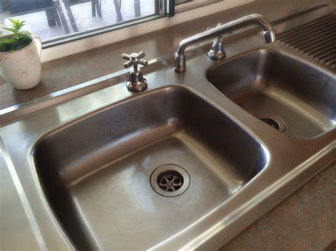 clean  kitchen sink  harsh chemicals