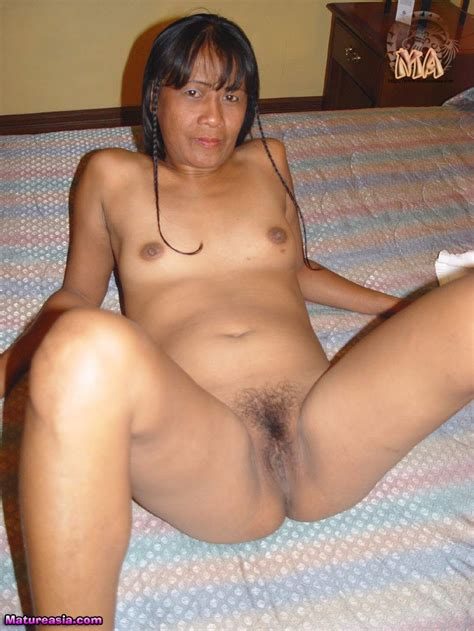 Dark skinned amateur Asian Grandma taking a shower before hardcore porn sex
