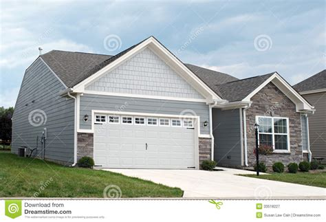 Two Luxury Single Family Houses With And Grey Decor by Condo With Two Car Garage Royalty Free Stock Photography