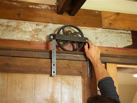 sliding cabinet door track hardware barn door project how to build a sliding barn door diy barn door how tos