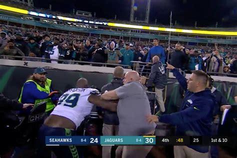 jaguars fan throwing bottle  seahawks player isnt