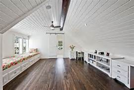 View In Gallery Spacious Airy And Bright Attic Family Room Playroom Room Over The Garage Floor Plan Idea With Sectional Room Over Garage Finished Room Over Garage Design Ideas Room Over Barndominium Floorplans And Design Girl Gloss