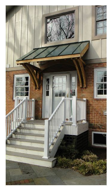 custom cedar brackets  metal roof front porch house entrance