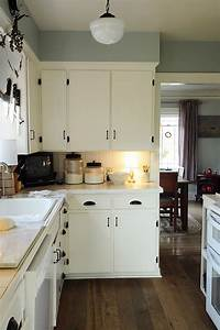 we have an old new england cottage with lots of knotty With kitchen colors with white cabinets with wooden panel wall art