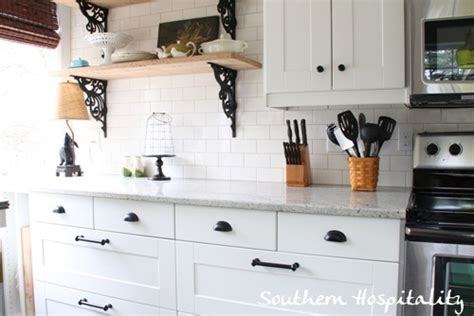 white kitchen cabinets with rubbed bronze hardware ikea kitchen renovation cost breakdown 2261