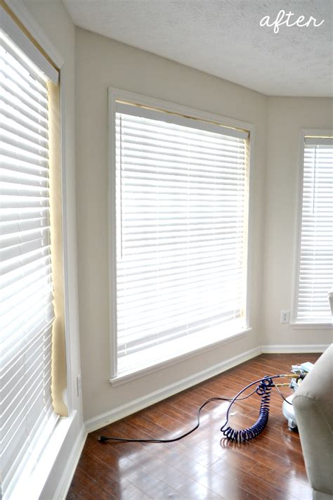 adding trim   living room windows ugly duckling house