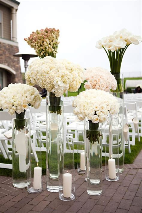 flowers  tall votives aisle decor wedding