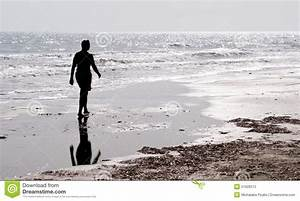 Man Walking Alone In The Beach Stock Photo - Image: 51928373