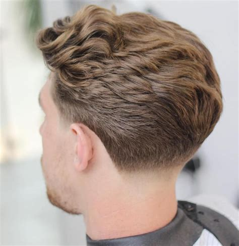 50 statement medium hairstyles for taper fade wavy