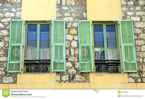 rustic wood siding rustic windows with green shutters provence