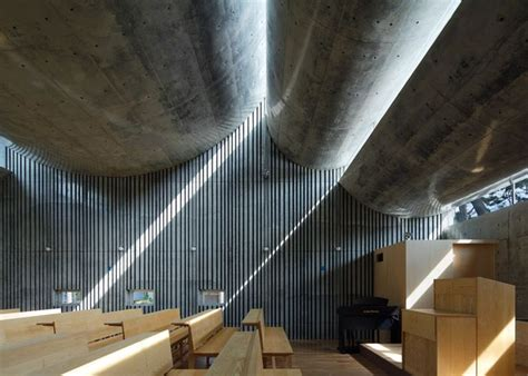 Six curving concrete slabs top a Japanese church by