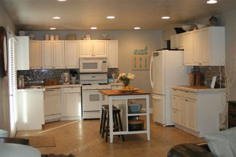 How To Refinish Kitchen Cupboards by Stitched How To Refinish Your Kitchen Cabinets And