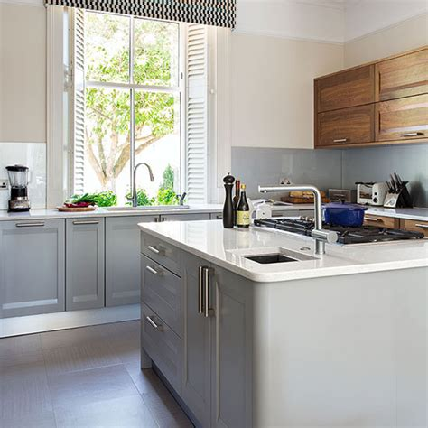 pale grey kitchen cabinets pale grey kitchen with walnut units decorating ideal home 4085