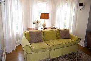 Perfect living room filled with pleasant lime green sofa for Couch and sofa table in front of window