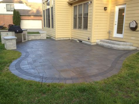unilock brick pavers mendoza unilock umbriano paver patio and built in grill in