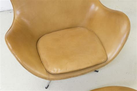 Fritz Hansen Egg Armchair And Its Footrest In Leather And