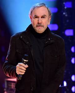 Neil Diamond retires from touring following Parkinson's ...