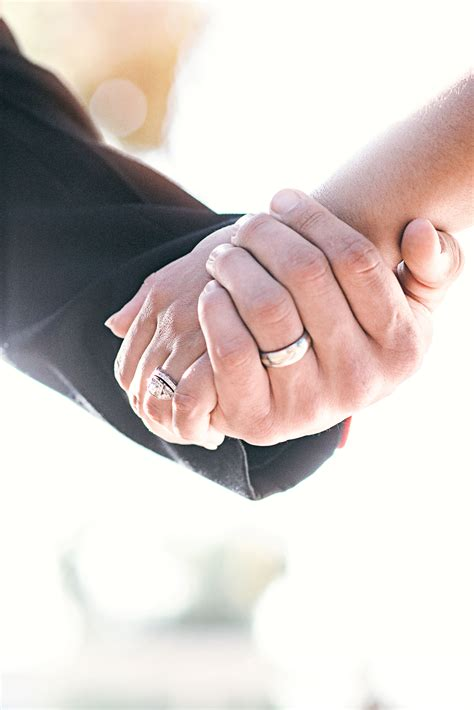 Get started and make your personalised wedding website today. Holding Hands With Wedding Rings