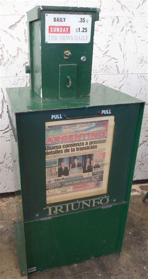 GREEN METAL NEWSPAPER STAND (SPANISH) ? Miami Prop Rental