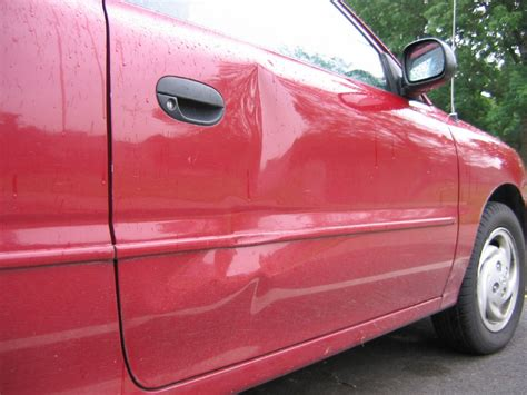 How To Fix Dent In Car Door by How To Fix A Dent In Your Car Simplemost