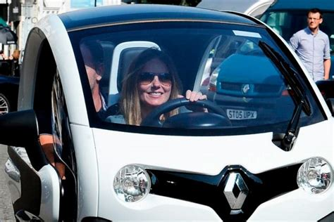 geri horner formula 1 geri horner takes the wheel as she drives tiny electric