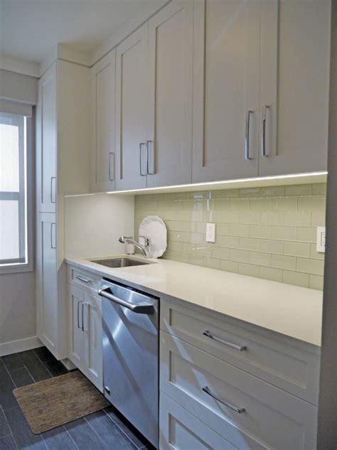 celadon green glass subway tile backsplash   custom designed white shaker inspired