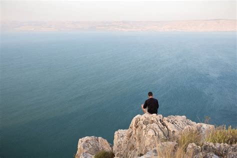 Perched On The Cliff Edge Overlooking The Sea by Climb The Cliffs Of Arbel National Park From The Grapevine