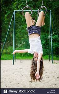 Girl, Hanging, Upside, Down, In, A, Playground, In, 2020