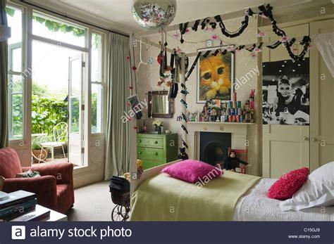 single  poster bed  teenage girls bedroom stock