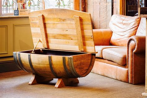 Recycled half whisky barrel coffee table with solid oak table top, jack daniel's logo and storage compartment. Bespoke wine barrel table, Coffee table, Solid french oak, hand made, Brass casement stay, Brass ...