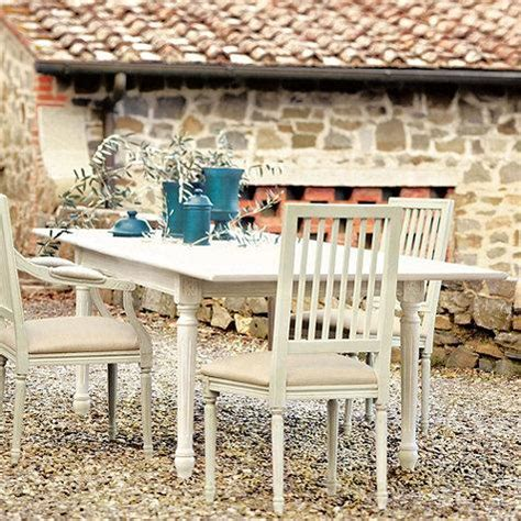 carved dining table  antique white