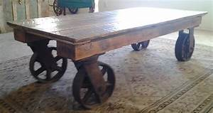 hand made coffee table with iron industrial wheels by the With industrial style coffee table with wheels