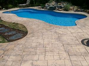 Floor beautiful swimming pool design ideas with stamp for Pool deck ideas made from concrete