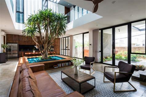 patio house rumah asri dengan ruang terbuka hijau yang