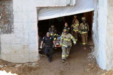 workers prepping  asbestos removal  injured