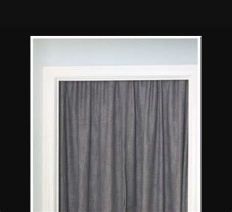 cover door with tension rod and curtain to soften a