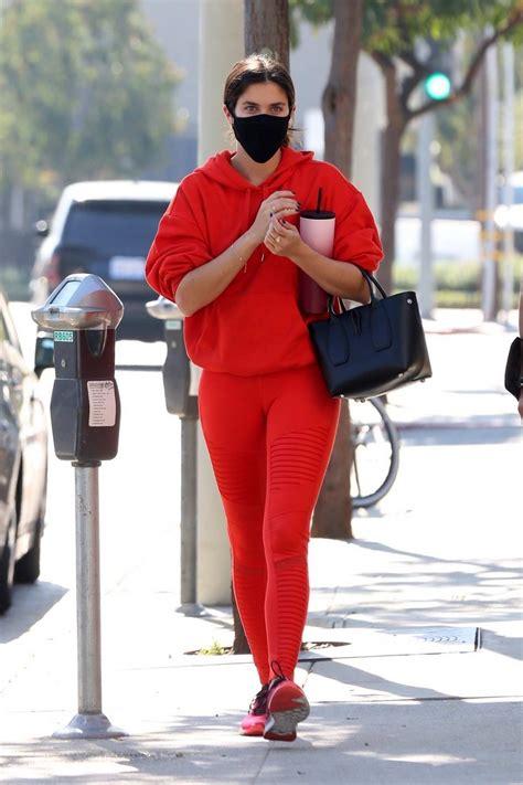Sara Sampaio looks striking in bright red leggings and ...
