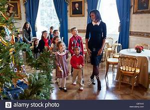 First Lady Michelle Obama walks with children past the ...