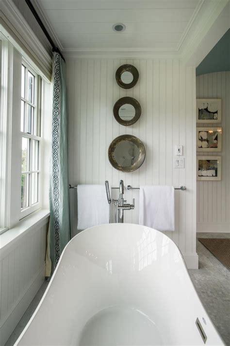 master bathroom  artistic mirrors  bathtub hgtv