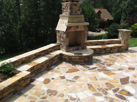 tennessee fieldstone fireplace and seating wall with a tennessee flagstone patio by edge