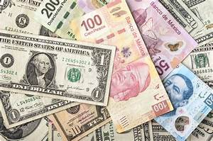Dollar And Mexican Peso Bills Stock Photo