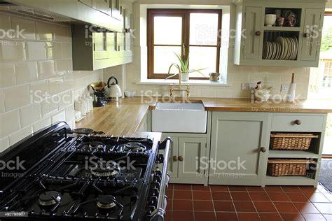 traditional country kitchen gas range cooker belfast sink wooden worktops stock photo