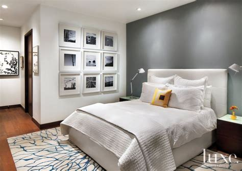 white master bedroom  gray accent wall gray accent