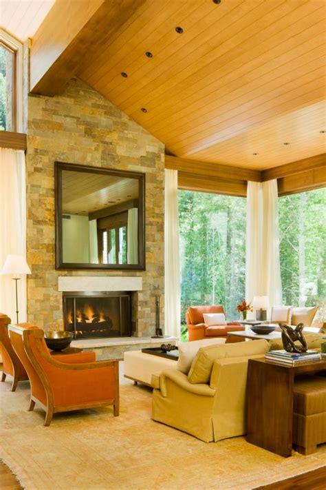 transitional living room  stone fireplace  high