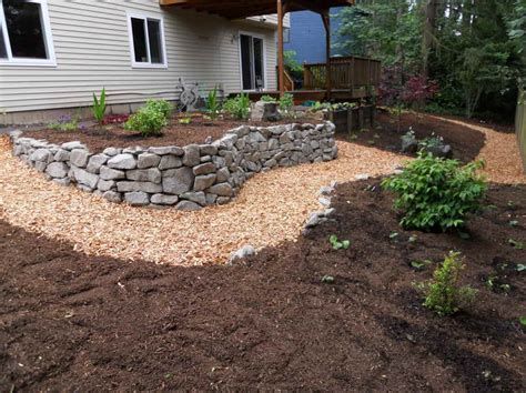 rock retaining wall cost walls how to determine retaining wall cost with stone placing how to determine retaining wall