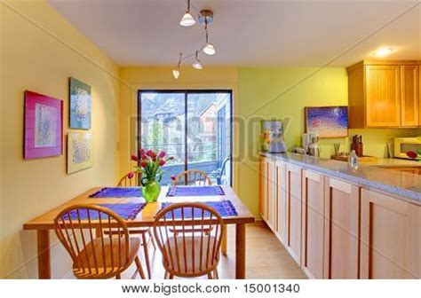 yellow and purple kitchen happy yellow and purple kitchen and dining table stock photo stock images bigstock