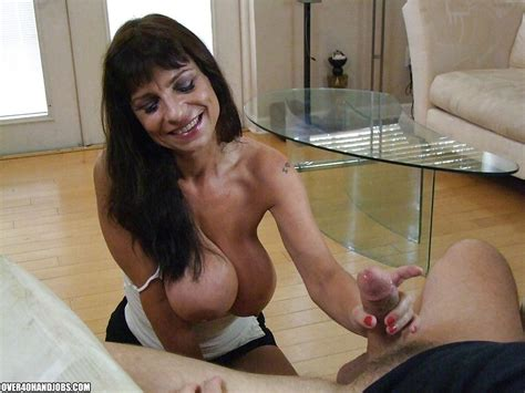 fuckable mature brunette with massive knockers gives a sensual handjob at mature sex pictures