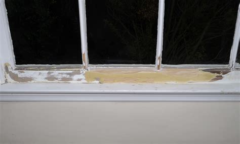 window sill repair rotted putty hard around holes trim sand flush self rock areas voids drilled thorough patched cracks cure