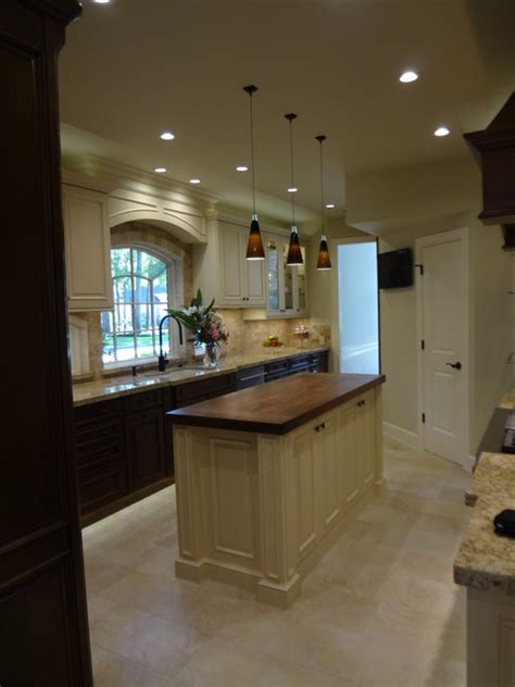 kitchen oven cabinets kitchen by maggie grants traditional kitchen houston 2389