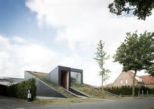 level house sloped green roof covers split level home